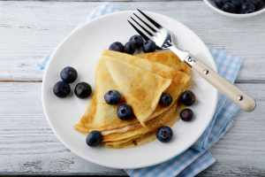 Delicious pancakes with berries. Sweet Dessert