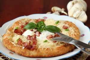 Langos, traditional Hungarian pancake with cheese, bacon, and garlic